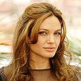Анджелина Джоли като прелъстителката на Томас Краун
